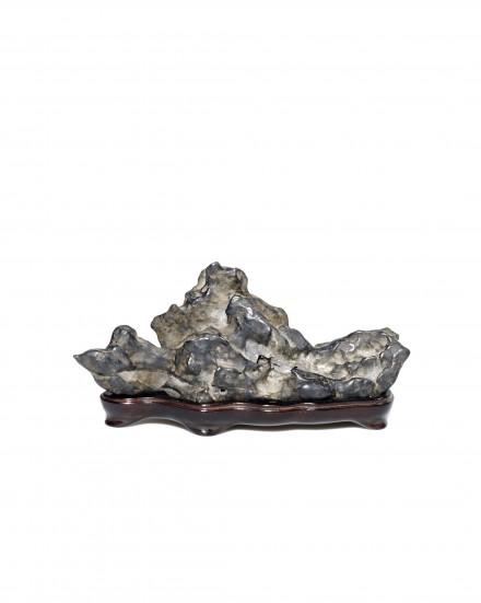 A SMALL MOUNTAIN-FORM LINGBI SCHOLAR'S ROCK