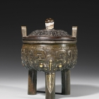 A GOLD- AND SILVER-INLAID ARCHAISTIC BRONZE TRIPOD CENSER