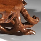 A CARVED BOXWOOD ROOT-FORM LOW TABLE
