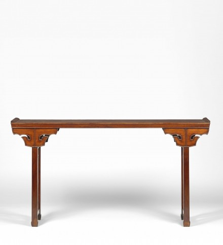 A HUANGHUALI TABLE WITH 'TAOTIE' SPANDRELS
