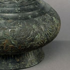 A BRONZE VASE WITH ENGRAVED DECORATION