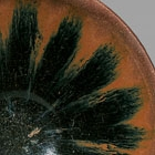 A JIANYAO 'STARBURST' BLACK- AND BROWN-GLAZED TEA BOWL