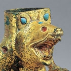 AN INLAID GILT BRONZE BEAR