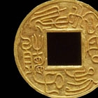 AN INSCRIBED GOLD MEDALLION-FORM AMULET