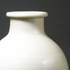 A TALL WHITE PORCELAIN VASE