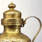 A GILDED SILVER COVERED EWER AND WARMING BASIN
