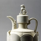 A WHITE PORCELAIN EWER AND COVER WITH WARMING BASIN, CUPS AND CUPSTANDS