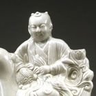 A MOULDED DINGYAO WHITE PORCELAIN FIGURAL EWER
