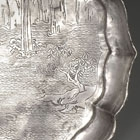 AN ENGRAVED SILVER 'RED CLIFF' PICTORIAL DISH