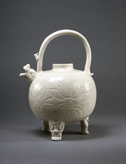 A CARVED WHITE PORCELAIN TRIPOD EWER