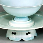 A YINGQING PORCELAIN FLOWER-SHAPED WINECUP AND STAND