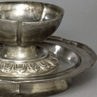 A SILVER FLOWER-SHAPED WINECUP AND STAND