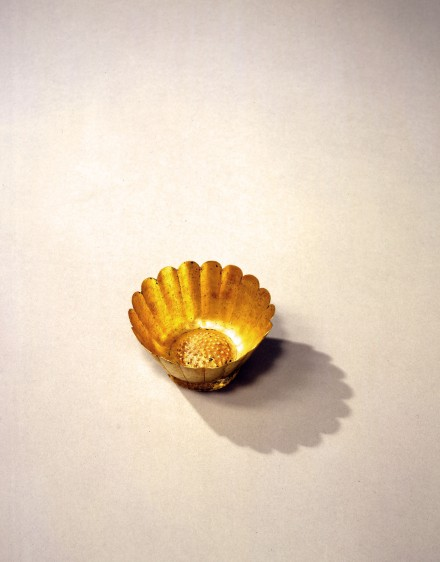 A SMALL GOLD FLOWER-FORM BOWL