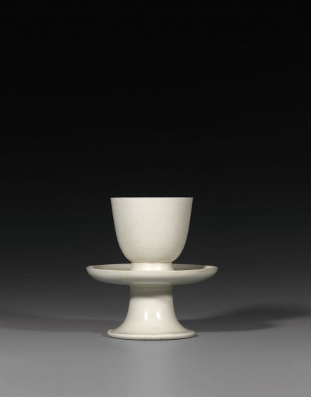 A CUP AND PEDESTAL STAND