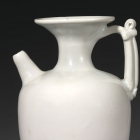 AN EWER WITH TRUMPET NECK