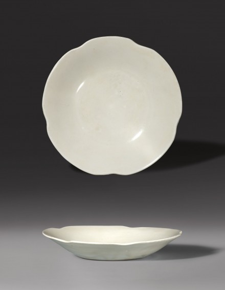 AN INSCRIBED FLOWER-SHAPED DISH