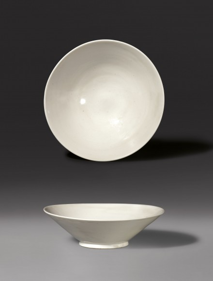 A THINLY POTTED CONICAL BOWL