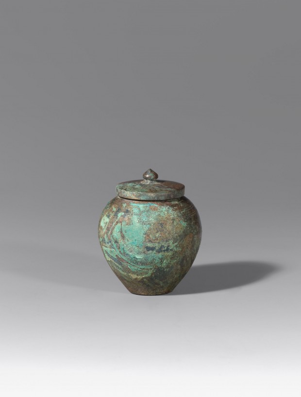 A SMALL BRONZE COVERED JAR