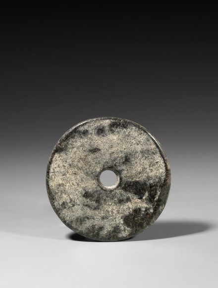 A NEOLITHIC DARK GREEN JADE BI DISC