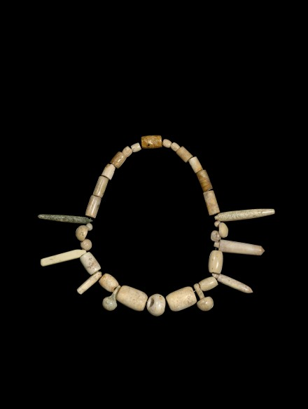 A NECKLACE OF NEOLITHIC JADE BEADS