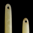 TWO LONG ROD SHAPED JADE ORNAMENTS