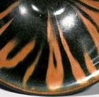 A YAOZHOU RUST-DECORATED BLACK-GLAZED BOWL