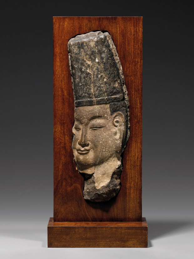 A LIMESTONE RELIEF HEAD OF A DIGNITARY