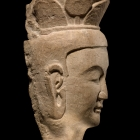 A LIMESTONE HEAD OF A BODHISATTVA