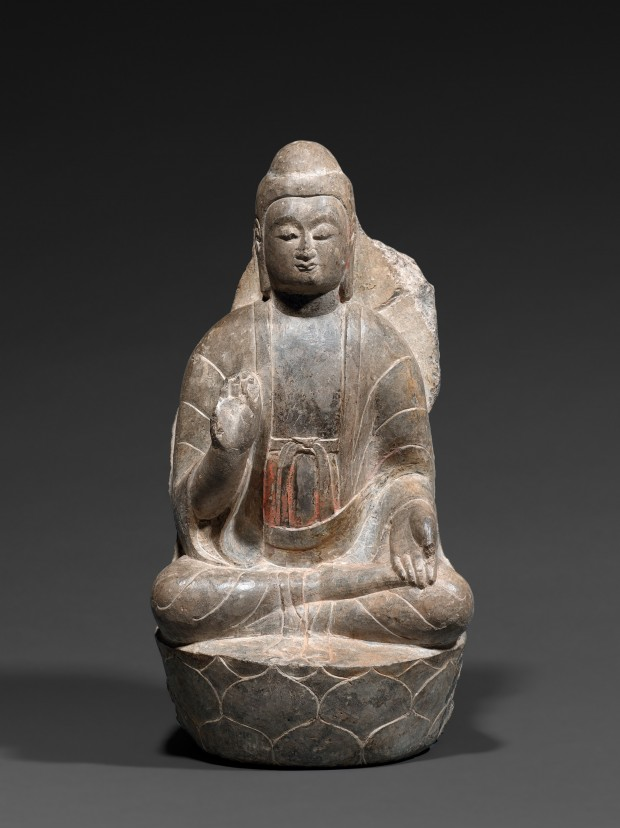 A LIMESTONE FIGURE OF BUDDHA ON A LOTUS THRONE