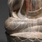 A LIMESTONE FIGURE OF BUDDHA ON A LOTUS THRONE