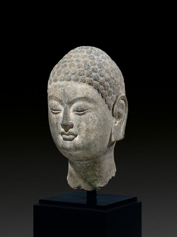 A LIMESTONE HEAD OF BUDDHA