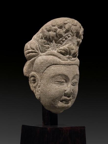 A SANDSTONE HEAD OF A BODHISATTVA