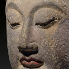 A LARGE SANDSTONE HEAD OF A BODHISATTVA