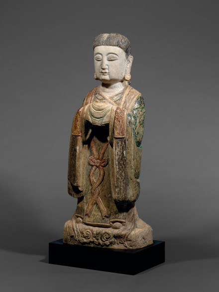 A PAINTED MARBLE FIGURE OF AN ATTENDANT DEITY