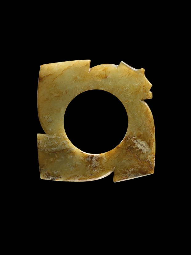 A NEOLITHIC JADE NOTCHED DISC (YABI)