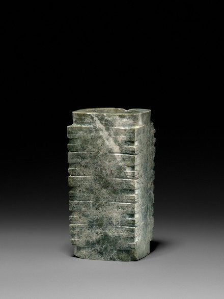 A NEOLITHIC MOTTLED GREEN JADE CONG