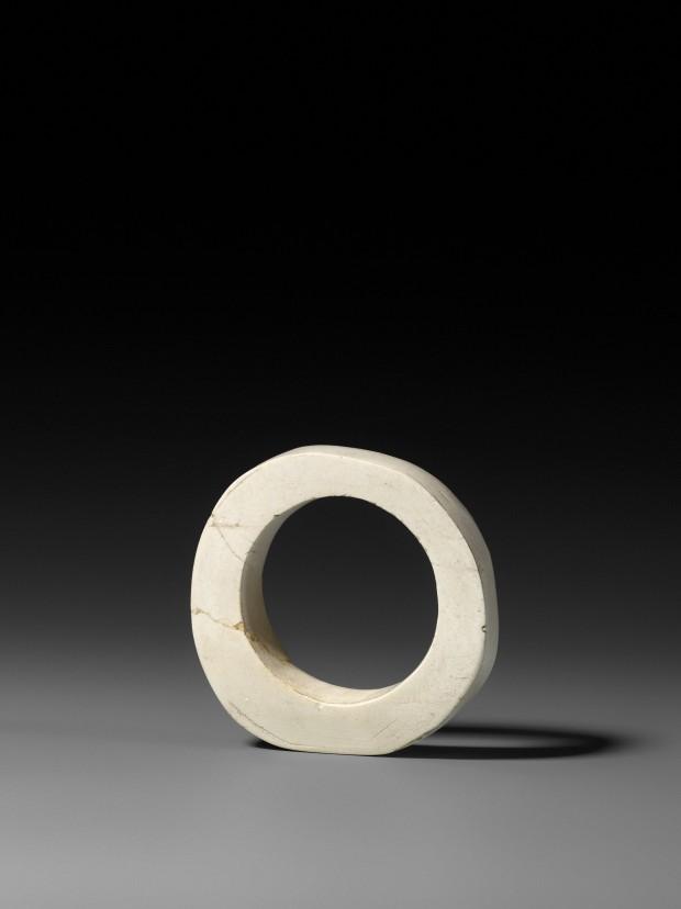 A NEOLITHIC WHITE JADE BRACELET (ZHUO)