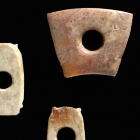 THREE SMALL NEOLITHIC JADE ORNAMENTS