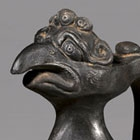 A BLACK BURNISHED POTTERY 'PHOENIX-HEAD' EWER