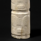 A CARVED NEOLITHIC JADE CYLINDRICAL BEAD