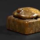 AN ARCHAIC BROWN JADE TORTOISE SEAL