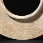 AN ARCHAIC JADE COLLARED DISC (YUAN)