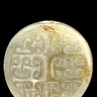AN ARCHAIC JADE DISC SHAPE BEAD