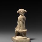 A WHITE MARBLE FIGURE OF A COURTESAN
