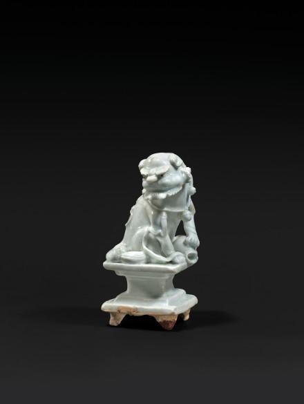 A QINGBAI GLAZED PORCELAIN BUDDHIST LION