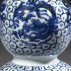 A SMALL MING BLUE AND WHITE PORCELAIN DOUBLE-GOURD 'DRAGON' VASE
