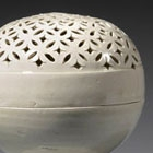 A GLAZED WHITE PORCELAIN OPENWORK CENSER