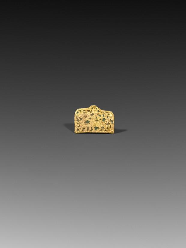 AN OPENWORK GOLD PLAQUE