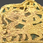 AN OPENWORK GOLD PLAQUE