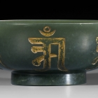 A GREEN JADE BUDDHIST 'PURE WATER BOWL'
